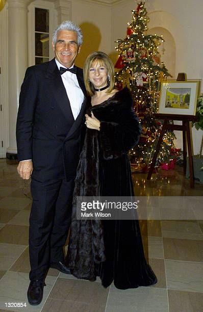 Barbra Streisand and her husband James Brolin arrive at the White House December 20 2000 in Washington DC Earlier in the day Streisand recieved a...