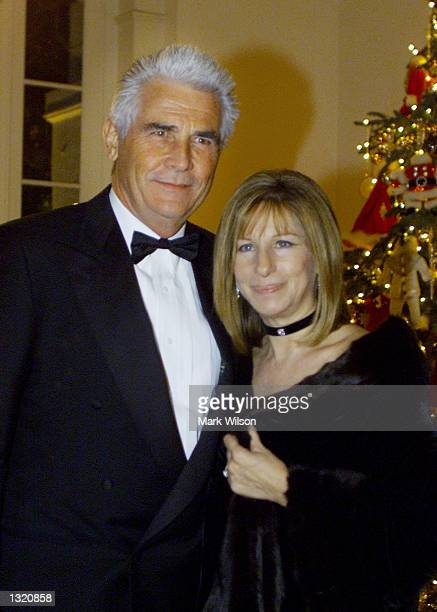 Barbra Streisand and her husband James Brolin arrive at the White House December 20 2000 in Washington DC Earlier in the day Streisand received a...
