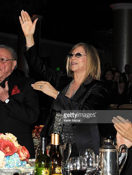 Barbra Streisand applauds after Jennifer Hudson's performance at the 52nd Annual GRAMMY Awards Salute To Icons Honoring Doug Morris held at The...
