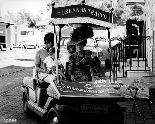 Barbra Streisand driving a buggy and her son Jason Gould in his baby sitter arms on the set of Hello Dolly USA 1968