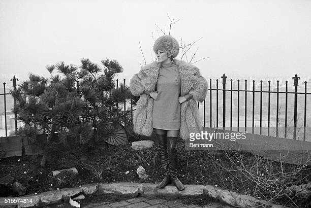 Barbra Streisand in a fur coat and hat with thighhigh boots wins second spot in the imaginative category for the second annual Best Dressed list