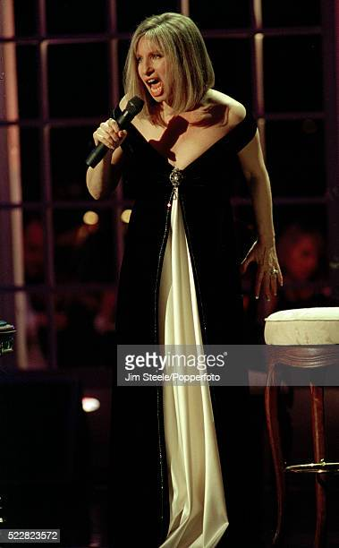 Barbra Streisand performing on stage at the Wembley Arena in London, circa April 1994.
