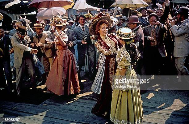 Barbra Streisand says goodbye to a girl in a scene from the film 'Hello Dolly' 1969