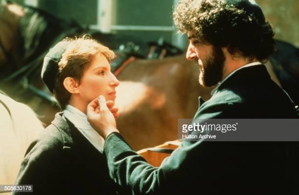 Barbra Streisand says goodbye to Mandy Patinkin in a scene in the movie Yentl circa 1983