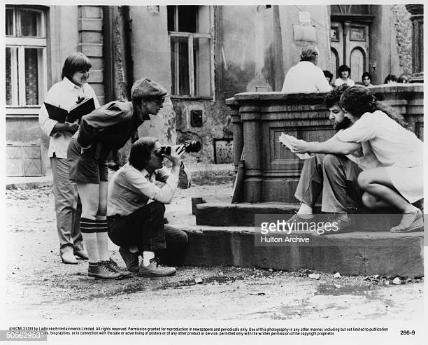 Barbra Streisand stands to direct Mandy Patinkin and Amy Irving in a scene in the movie 'Yentl' circa 1983