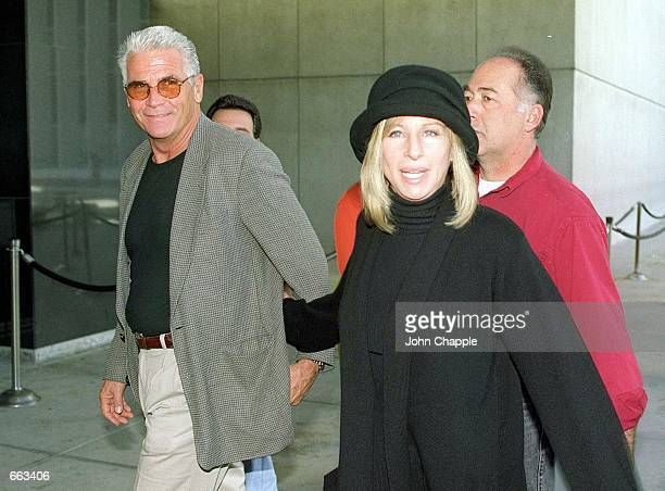 Barbra Streisand walks with husband James Brolin to a demonstration where she spoke against the impeachment of President Bill Clinton December 16...