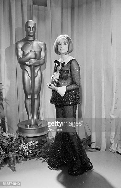 Barbra Streisand with the Oscar she won for Best Actress in Funny Girl. That same year Katharine Hepburn also won Best Actress, a rare split decision.