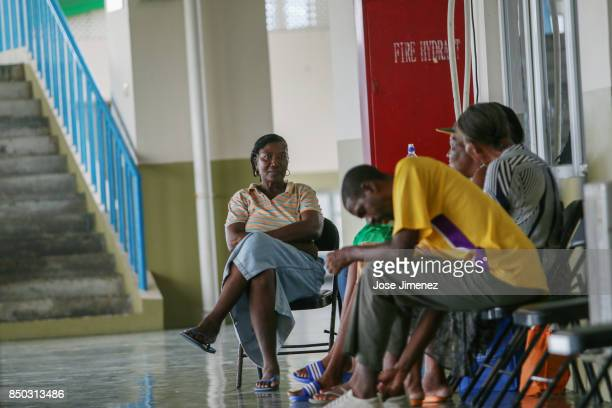 Barbuda residents wait at a shelter in the Sir Vivian Richards Cricket Stadium on September 20 2017 in North Sound Antigua and Barbuda Refugees from...
