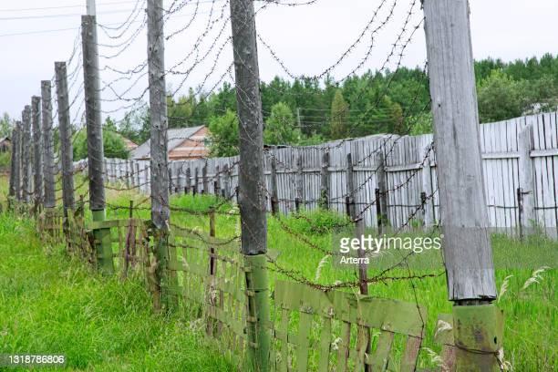 Barbwire fence at Gulag Perm-36 / ITK-6 / Gulag Museum, Soviet forced labour camp near the village Kuchino, Perm Krai, Russia.