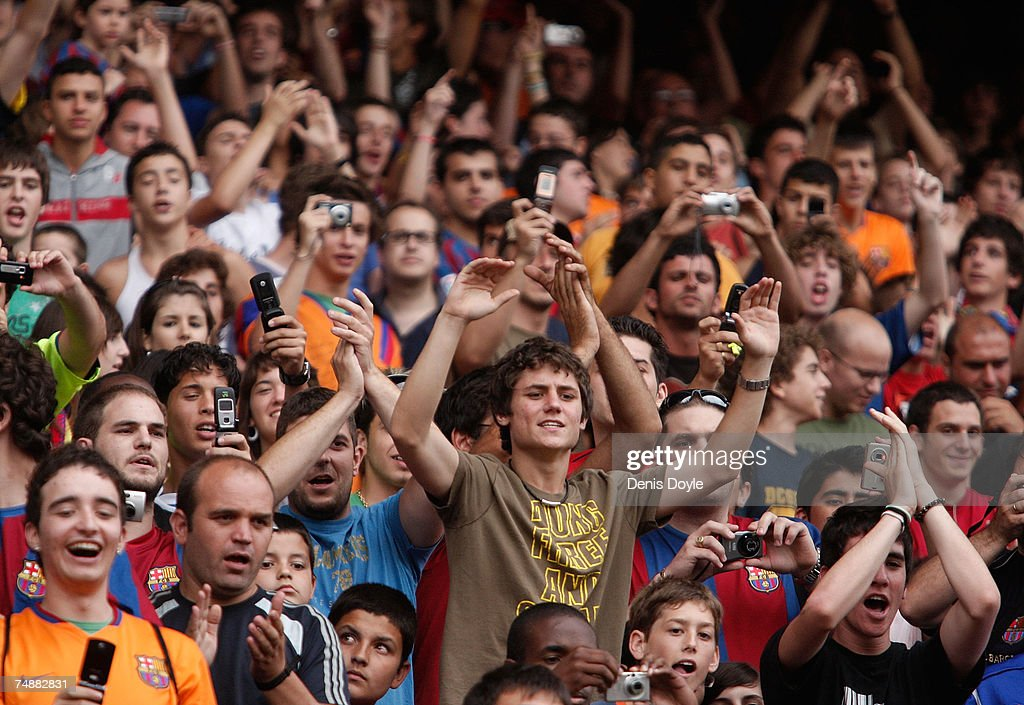 Barca fans cheer during the presentation of French player Thierry Henry at the Camp Nou stadium after he signed for Barcelona on June 25, 2007 in Barcelona, Spain.