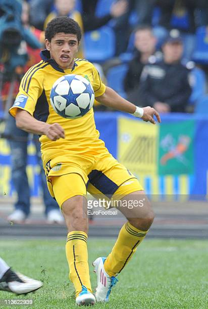 Barcellos Freda Taison of FC Metalist Kharkiv in action during their Ukrainian Premier League match against FC Karpaty Lviv on April 30, 2011 in...