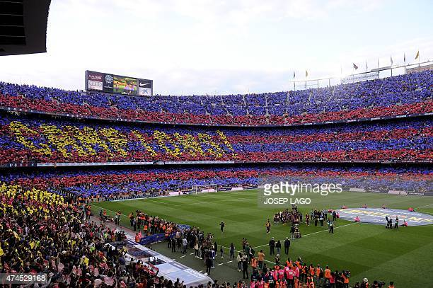 Barcelola's supporters holdup coloured rectangular posters to form a giant mosaic reading 'Champions' during the Spanish league football match FC...