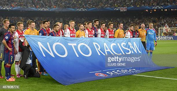 Barcelona and Ajax's players pose with a baner against racism before the UEFA Champions League football match FC Barcelona vs Ajax Amsterdam at the...