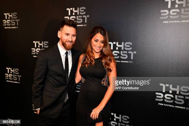 Barcelona and Argentina forward Lionel Messi and his wife Antonella Roccuzzo pose for a photograph as they arrive for The Best FIFA Football Awards...