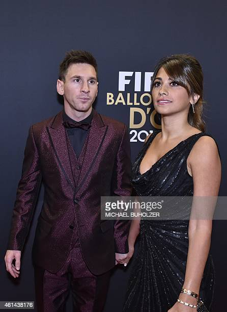 Barcelona and Argentina forward Lionel Messi and his wife Argentinian model Antonella Roccuzzo pose as they arrive during the red carpet ceremony...