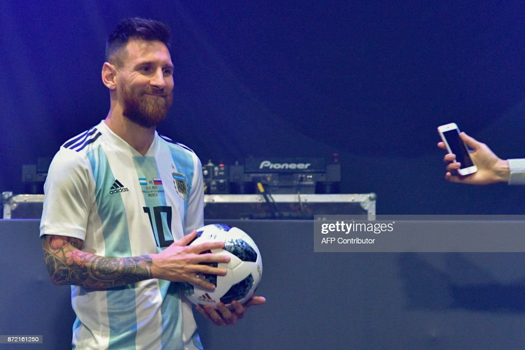 fdbf54c26 Barcelona and Argentina forward Lionel Messi poses with the official ...