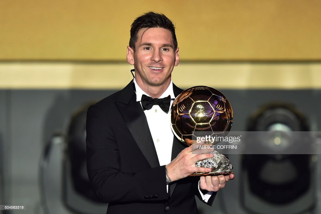 Barcelona and Argentina's forward Lionel Messi poses with trophy after receiving the 2015 FIFA Ballon dOr award for player of the year during the 2015 FIFA Ballon d'Or award ceremony at the Kongresshaus in Zurich on January 11, 2016.