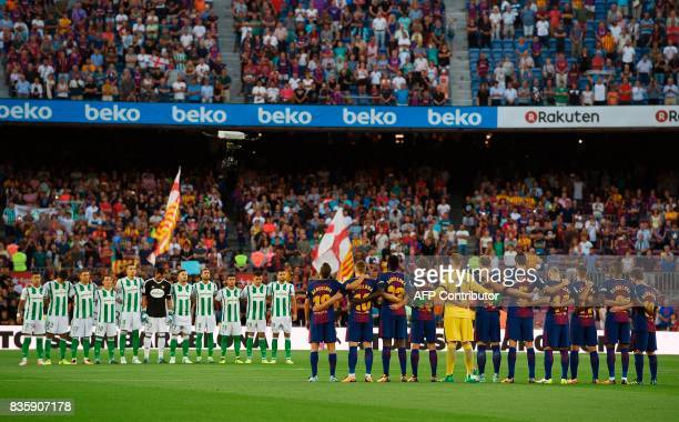 TOPSHOT Barcelona and Betis's football players observe a minute of silence as they wear jerseys reading 'Barcelona' instead of their names to pay...