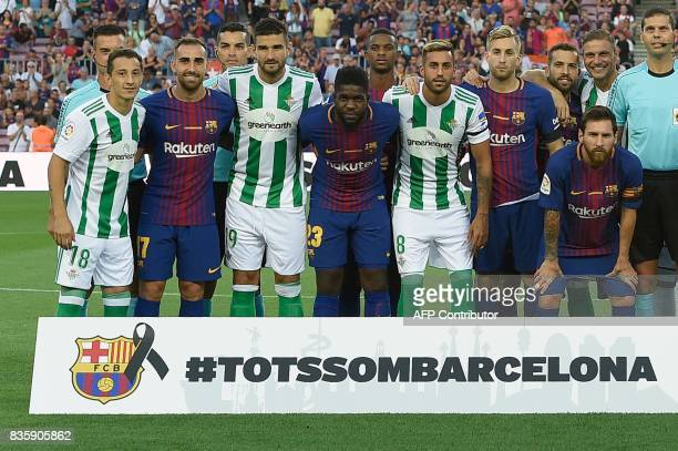 Barcelona and Betis's football players pose together after paying tribute to the victims of the Barcelona and Cambrils attacks before the Spanish...