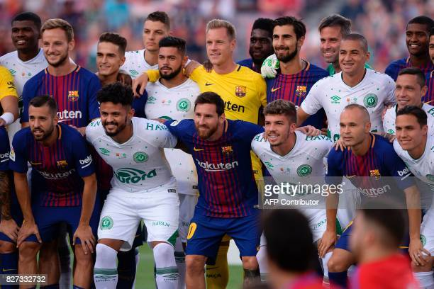 Barcelona and Chapecoense players pose before the 52nd Joan Gamper Trophy friendly football match between Barcelona FC and Chapecoense at the Camp...
