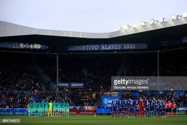 Barcelona and Deportivo Alaves players observe one minute of silence in honor of Angola victims prior to start the La Liga match between Deportivo...