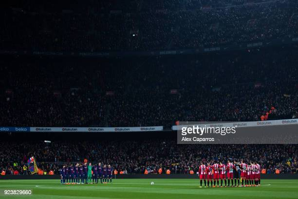 Barcelona and Girona FC players hold a minute of silence in memory of the Basque policeman who died during clashes outside San Mames stadium in...