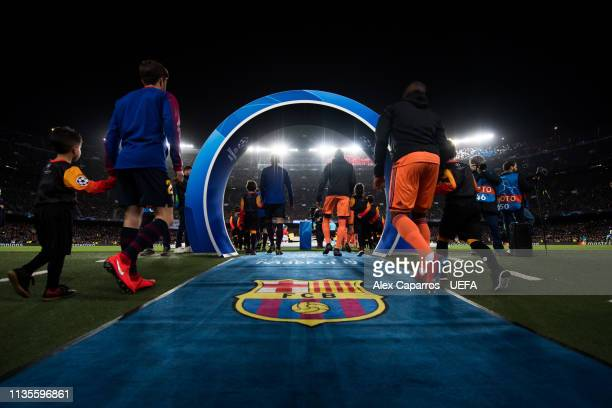 Barcelona and Olympique Lyonnais players enter the pitch for the UEFA Champions League Round of 16 Second Leg match between FC Barcelona and...