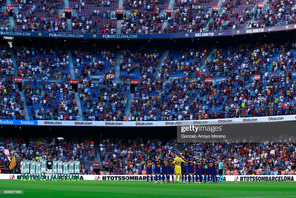 FC Barcelona and Real Betis players line up to observe a minute's silence in memory of victims of the terrorist attack in Barcelona this week prior to start the La Liga match between FC Barcelona and Real Betis Balompie at Camp Nou stadium on August 20, 2017 in Barcelona, Spain.