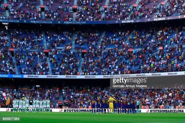 Barcelona and Real Betis players line up to observe a minute's silence in memory of victims of the terrorist attack in Barcelona this week prior to...