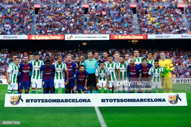 Barcelona and Real Betis players pose for a picture in memory of victims of the terrorist attack in Barcelona this week prior to start the La Liga...