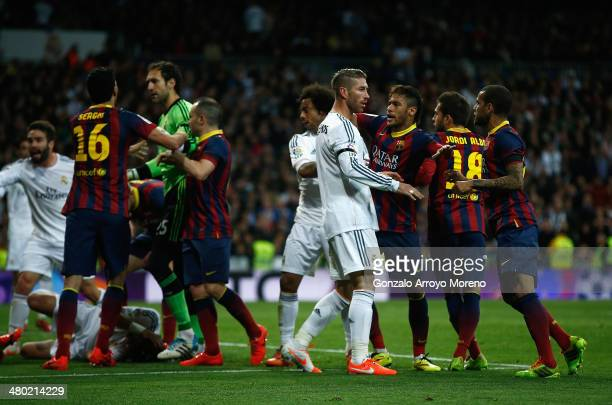 Barcelona and Real Madrid players including Sergio Ramos of Real Madrid and Neymar of Barcelona exchange words during the La Liga match between Real...
