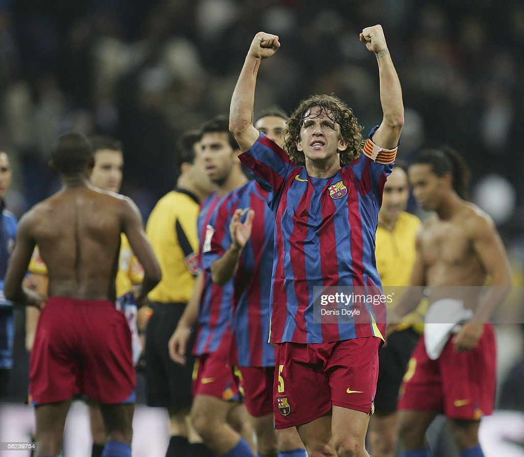 F.C Barcelona captain Carles Puyol celebrates after his team beat Real Madrid 3-0 during a Primera Liga match between Real Madrid and F.C. Barcelona at the Bernabeu on November 19, 2005 in Madrid, Spain.