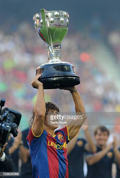Barcelona captain Carles Puyol holds the 20092010 La Liga trophy before the Joan Gamper Trophy match between Barcelona and AC Milan at Camp Nou...