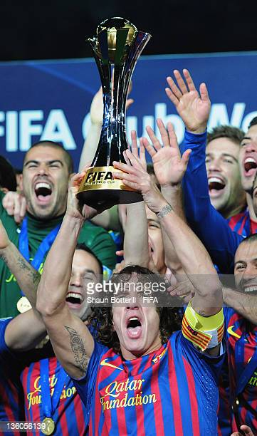 Barcelona captain Carles Puyol lifts the trophy amongst teammates celebrating after the FIFA Club World Cup Final match between Santos and Barcelona...