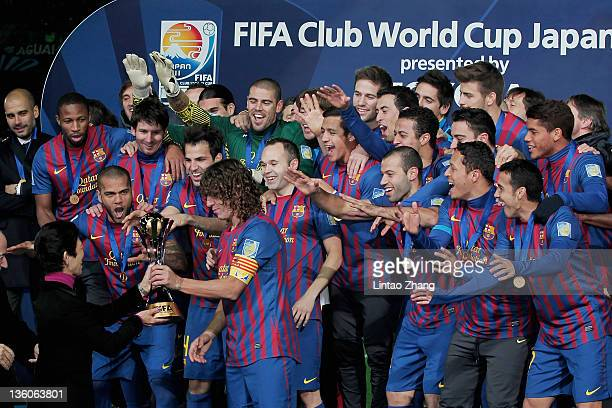 Barcelona captain Carles Puyol lifts the trophy amongst teammates celebrating after the FIFA Club World Cup Final match between Santosl and Barcelona...