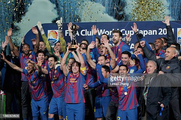 Barcelona captain Carles Puyol lifts the trophy amongst team-mates celebrating after the FIFA Club World Cup Final match between Santosl and...