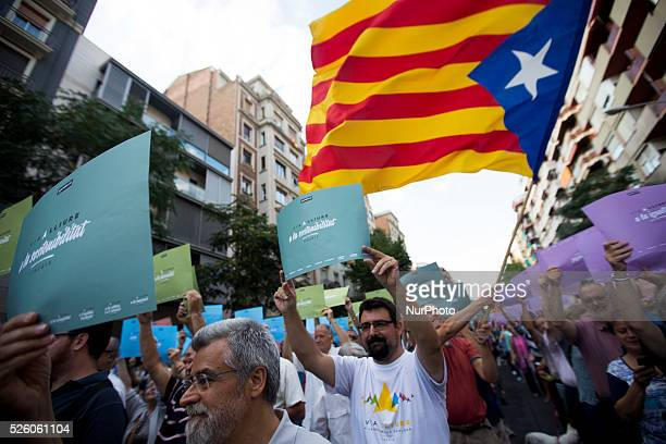 Barcelona Catalonia Spain August 18 Hundreds of members of the Catalan National Assamblea tested in the Gracia district the giant mural that...