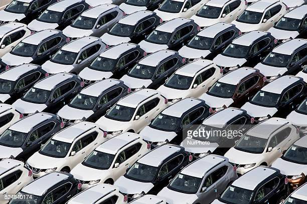 Barcelona Catalonia Spain Dozens of new cars in the car terminal of the port of Barcelona Catalonia Spain on December 23 2015 The automotive sector...