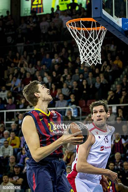 Barcelona Catalonia Spain January 23 2015 Tibor Pleiss of Barcelona and Boban Marjanovic of Belgrade in action during the 20142015 Turkish Airlines...