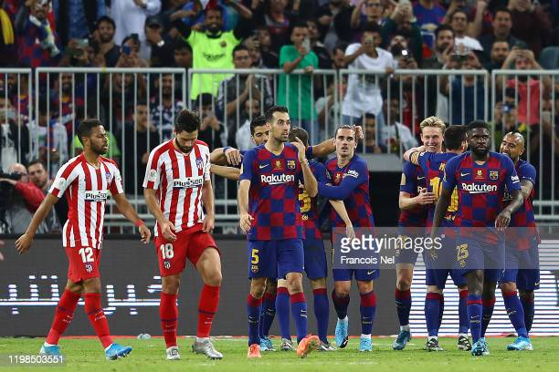 Barcelona celebrate their second goal during the Supercopa de Espana SemiFinal match between FC Barcelona and Club Atletico de Madrid at King...