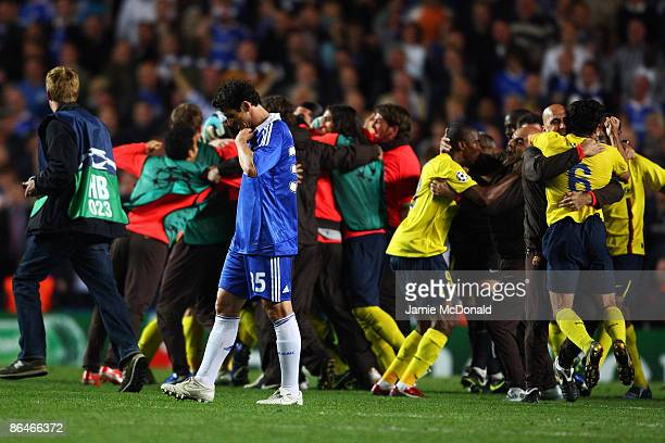 Barcelona celebrate victory in the UEFA Champions League Semi Final match between Chelsea and Barcelona as Juliano Belletti of Chelsea looks dejected...