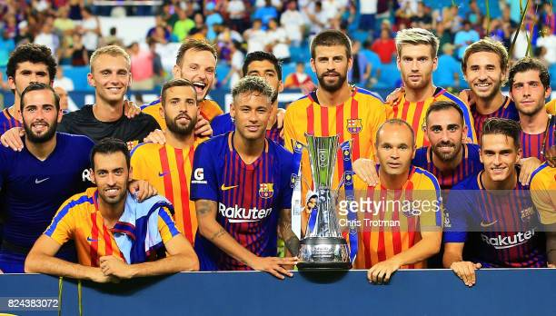 Barcelona celebrate with the trophy after defeating Real Madrid 3 to 2 in their International Champions Cup 2017 match at Hard Rock Stadium on July...