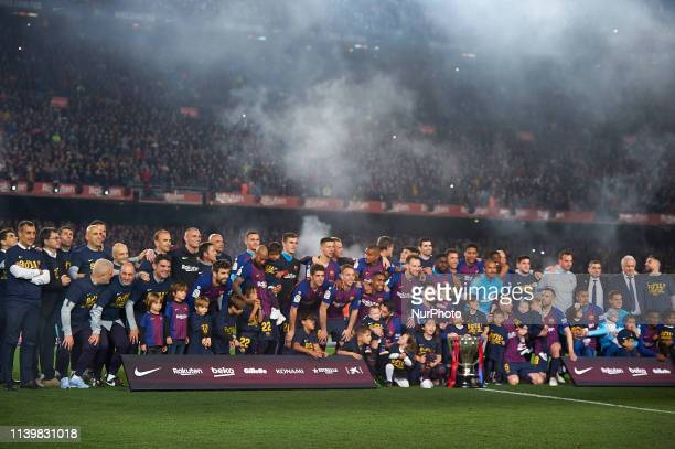 Barcelona celebrates after Barcelona won their 26th league title at the end of the Spanish League football match between Barcelona and Levante at the...
