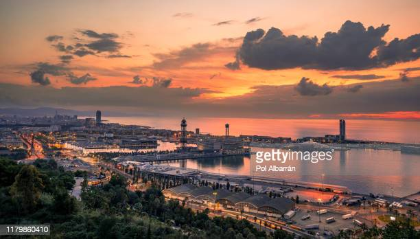barcelona city and port at sunrise. catalonia, spain - catalonia stock pictures, royalty-free photos & images