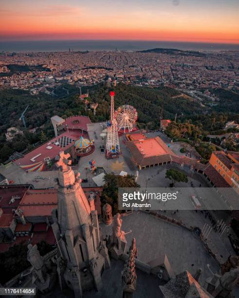 barcelona city from mountain top tibidabo at sunset. catalonia, spain - tibidabo stock pictures, royalty-free photos & images