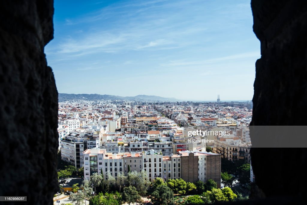 Barcelona city skyline, as seen from Basilica of the Sagrada Familia : Stock Photo