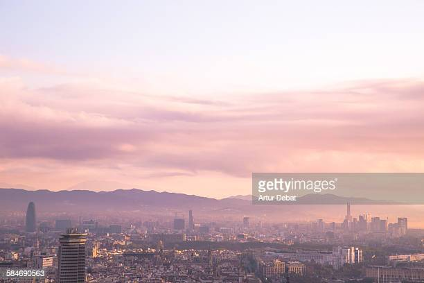 Barcelona cityscape with sunrise light.