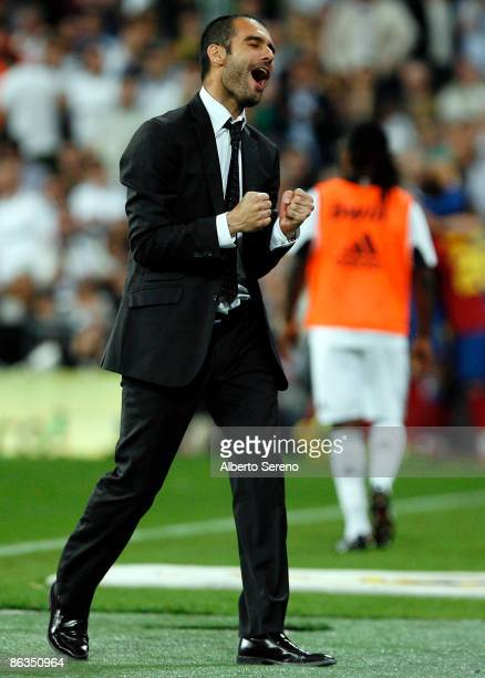 Barcelona coach Guardiola reacts after the goal of his team during the La Liga match between Real Madrid and FC Barcelona at the Santiago Bernabeu...