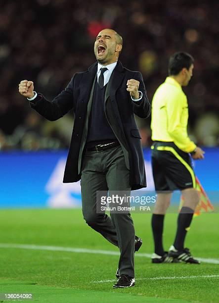 Barcelona coach Josep Guardiola celebrates the second goal during the FIFA Club World Cup Final match between Santos and Barcelona at the Yokohama...