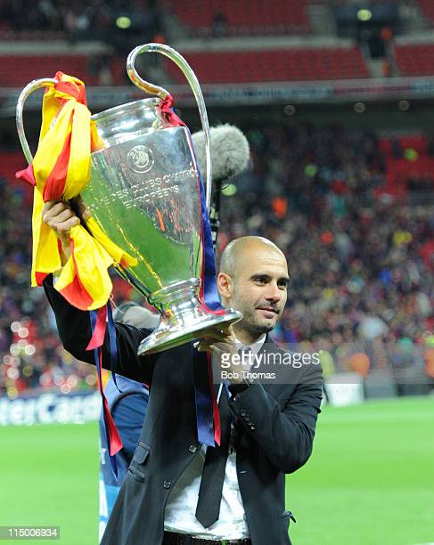 Barcelona coach Josep Guardiola celebrates with the trophy after the UEFA Champions League final between FC Barcelona and Manchester United FC at...